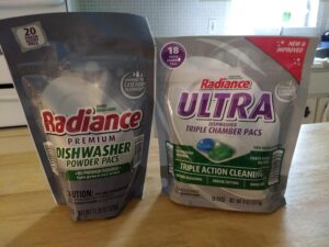 They replace Radiance Premium Dishwasher Powder Pacs.